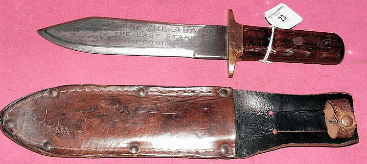 An old 29cm bowie knife with brass and wooden