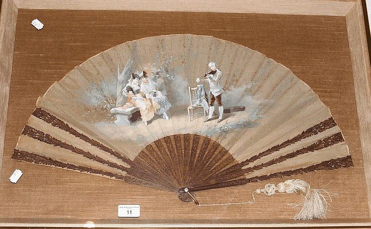 An old hand painted lady's fan with carved wooden