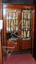 An inlaid Edwardian display cabinet