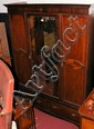 An Edwardian mahogany mirrored wardrobe with