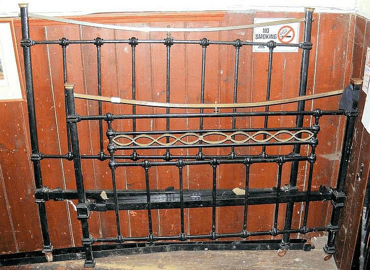 A Victorian cast iron and brass bedstead