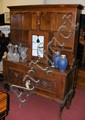 An oak dresser with carved front and cabriole