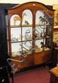 An Edwardian two door display cabinet on cabriole