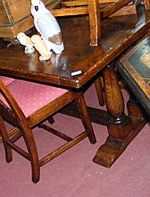 A good quality oak refectory style dining table on