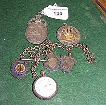 A silver Masonic medal, watch chain, etc