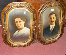 A pair of decoratively framed portraits