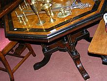 A Victorian walnut and ebony octagonal table with