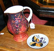 A Royal Doulton jug, together with a Moorcroft pin