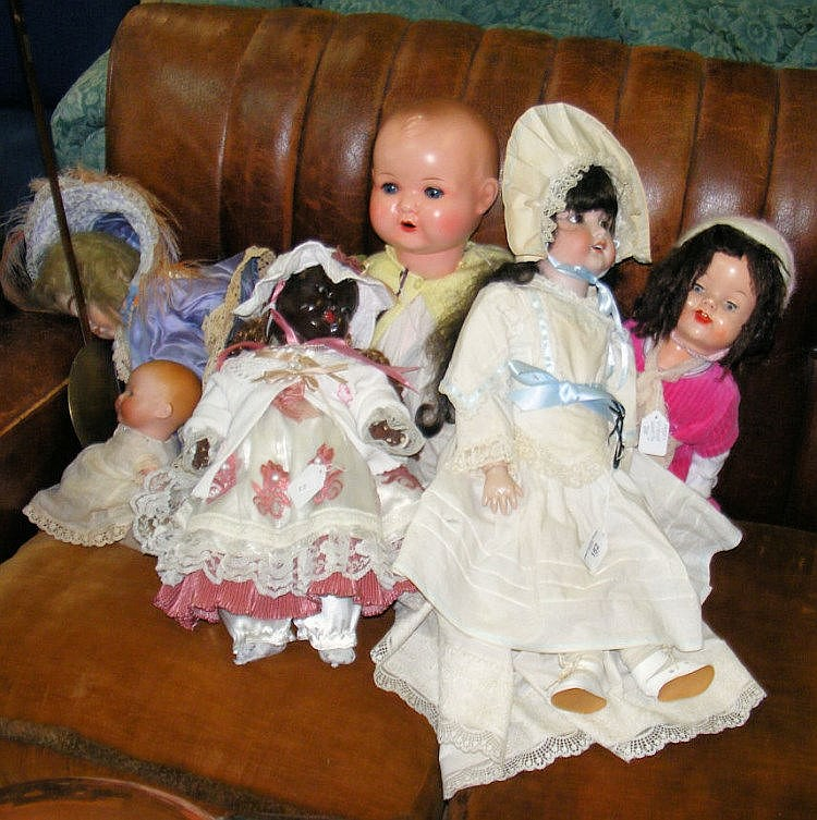 Selection of collectable dolls including Armand