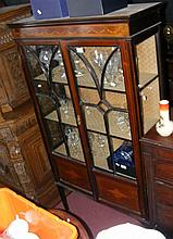 An Edwardian two door display cabinet