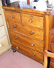 A Victorian mahogany cap top chest of drawers