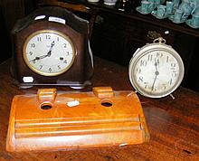An Art Deco ink stand, together with two clocks