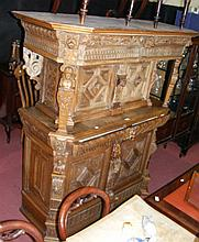 A carved continental court cupboard with single