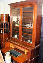 An Edwardian secretaire bookcase with carved front