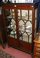 A display cabinet with glazed doors