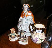 A Staffordshire figure, together with two Hummel