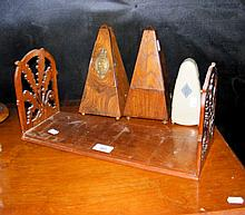 Three metronomes, together with a fretwork