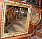 A 70cm square hanging wall mirror in ornate parcel