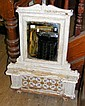 A painted cast metal overmantel with mirror and