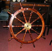 A modern wooden metal mounted ship's wheel