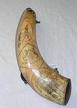 A rare engraved powder horn. The engraving