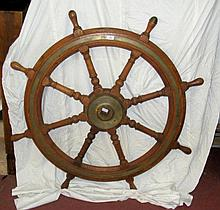 A large old wooden and brass mounted ship's wheel