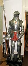 A reproduction full size suit of armour on stand