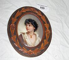 A 10cm x 7cm oval hand-painted porcelain plaque