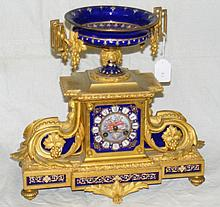 A 19th century French ormolu striking mantel clock