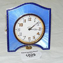 An 8-day travelling clock in decorative silver and