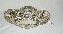 A decorative pierced silver basket with 925 mark -