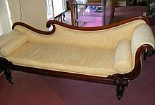 An early 19th century mahogany framed chaise