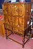 A continental style cabinet on stand with panelled