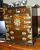 A decorative oriental small proportioned chest
