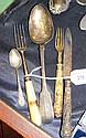 A silver teaspoon, knife, etc.
