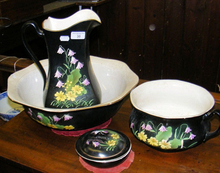 A four piece ceramic dressing table set
