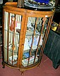 A 1930's walnut bow front display cabinet with two