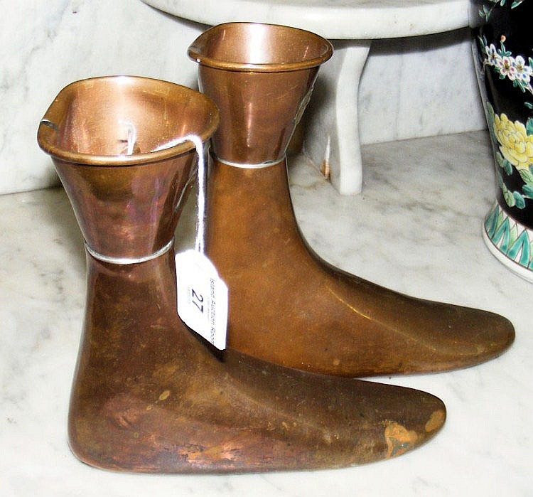 A pair of Edinburgh made copper boot warmers,