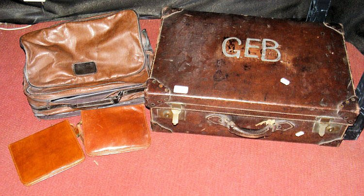 A leather suitcase, ditto holdall and two leather