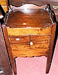 An antique mahogany commode