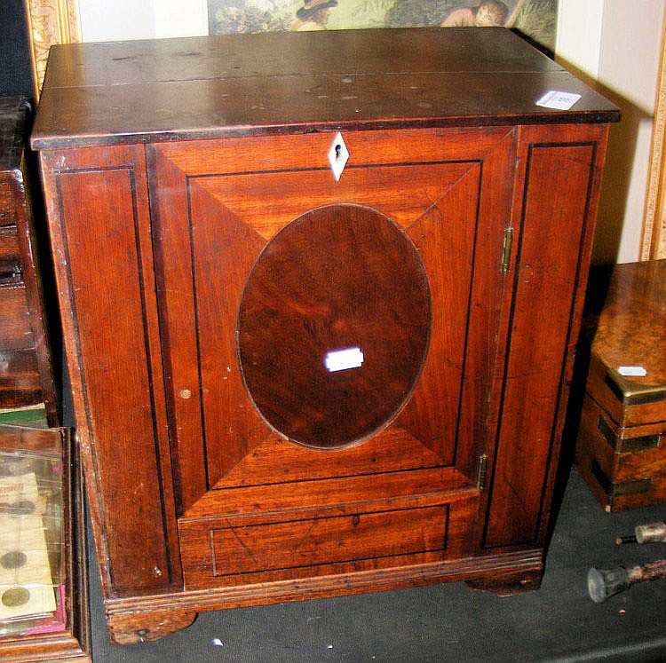 An inlaid mahogany apprentice piece cabinet in the