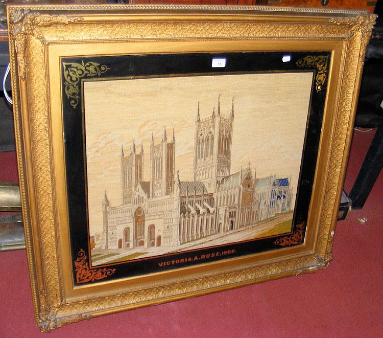 A 67cm x 79cm framed and glazed cathedral tapestry