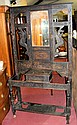 A carved oak hall stand with mirrored back