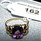 A 10K gold oval amethyst ring