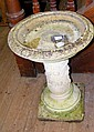 A stone birdbath on column support