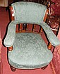 An antique easy chair with turned front supports