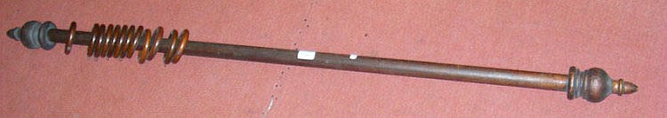 A 132cm Victorian curtain pole with turned finials
