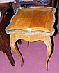 A French style inlaid side table with plate glass