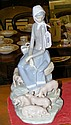 A large Lladro china ornament of seated young lady