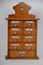 19th C. Czechoslovakian Spice Cabinet Nine-drawer maple Czechoslovakian hanging spice cabinet with porcelain spice tags and knobs, 12 1/4